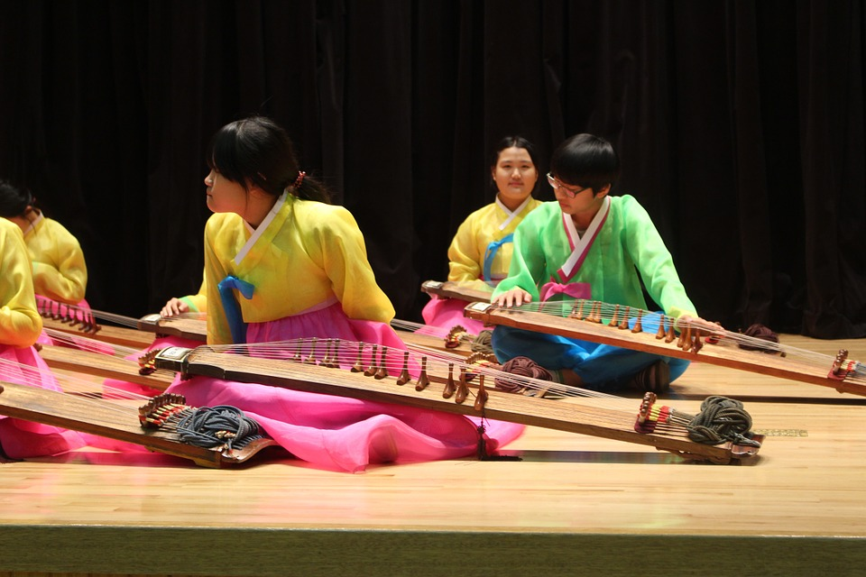 wearing hanbok and playing music at school trip in south korea
